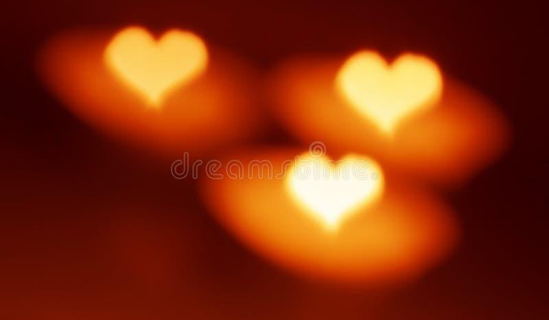 Forma del cuore, stile del bokeh, candele fotografia stock