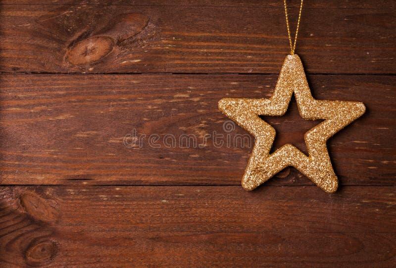 Forma della stella su fondo di legno immagine stock libera da diritti