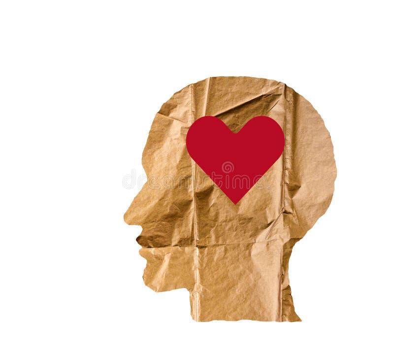 A forma di di carta sgualcito come una testa e cuore umani su bianco fotografie stock