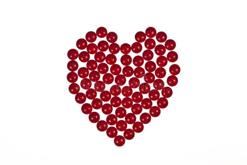 Forma do coração criada fora das tabuletas imagem de stock