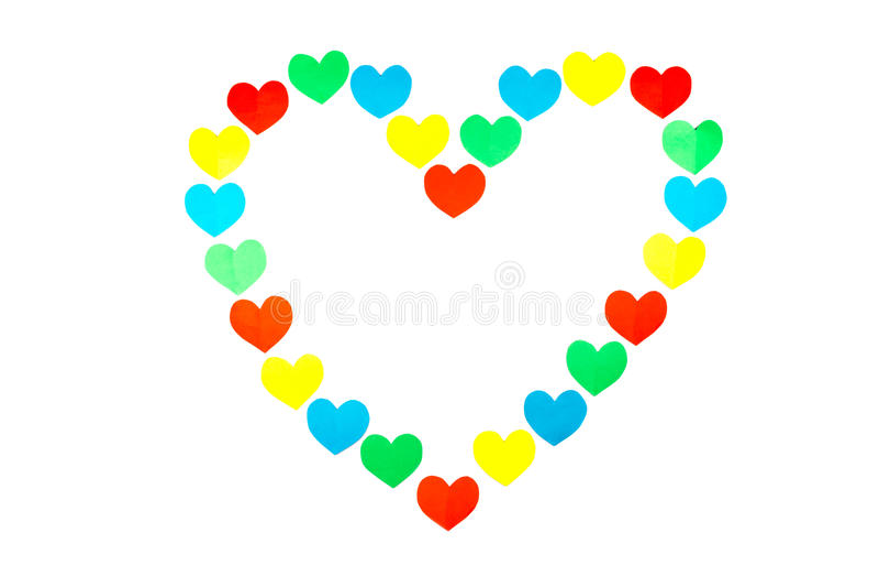 Forma do grande coração construída de corações coloridos pequenos no branco fotos de stock