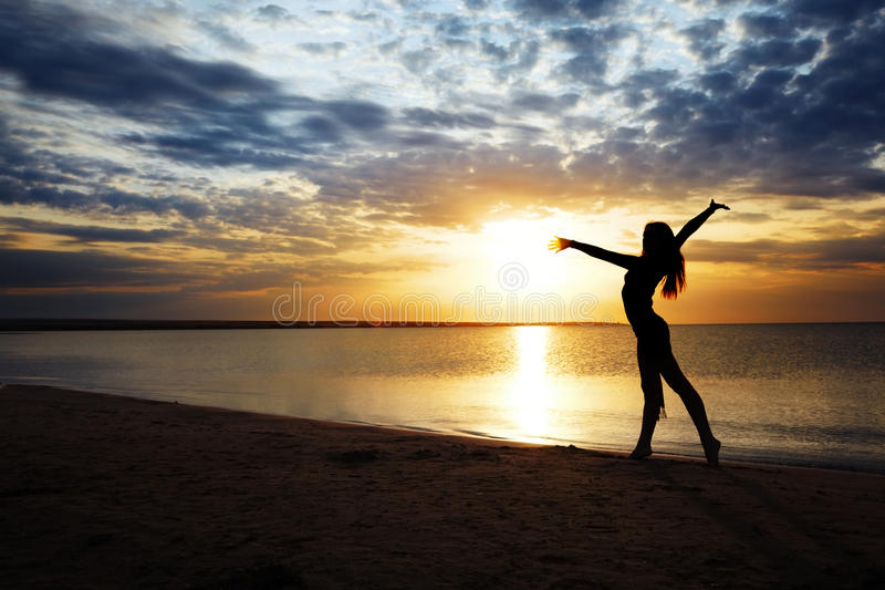 Forma fisica al tramonto fotografie stock