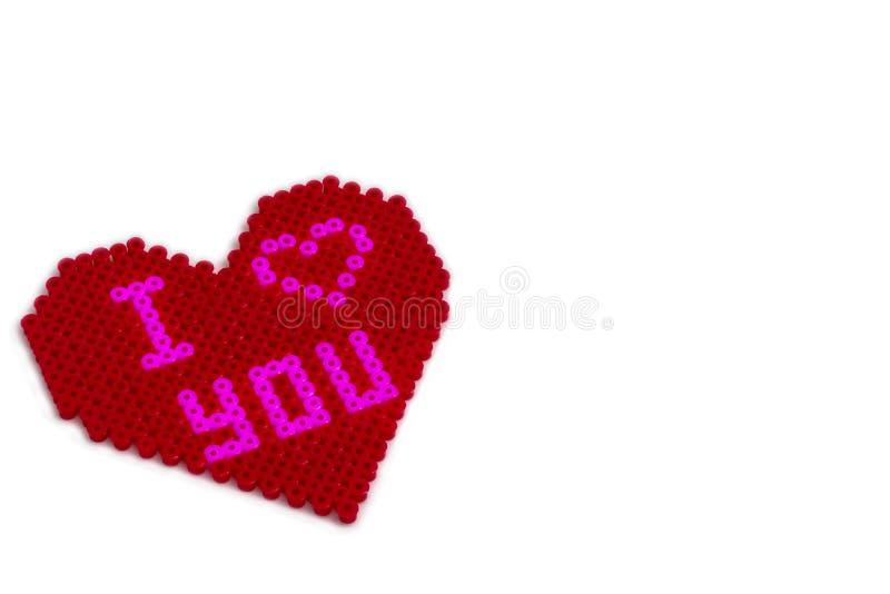 Forma fusible del corazón de las gotas con te amo imagen de archivo