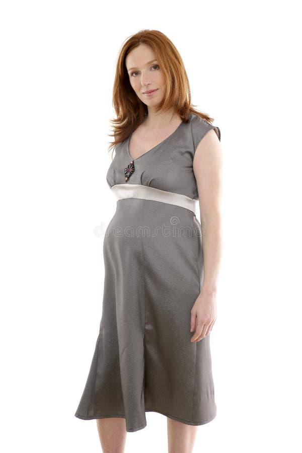Forma grávida bonita da mulher do redhead imagens de stock royalty free