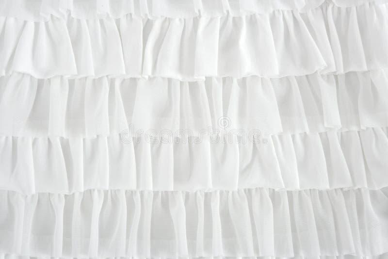 Forma plissada da tela da saia no close up branco fotografia de stock royalty free