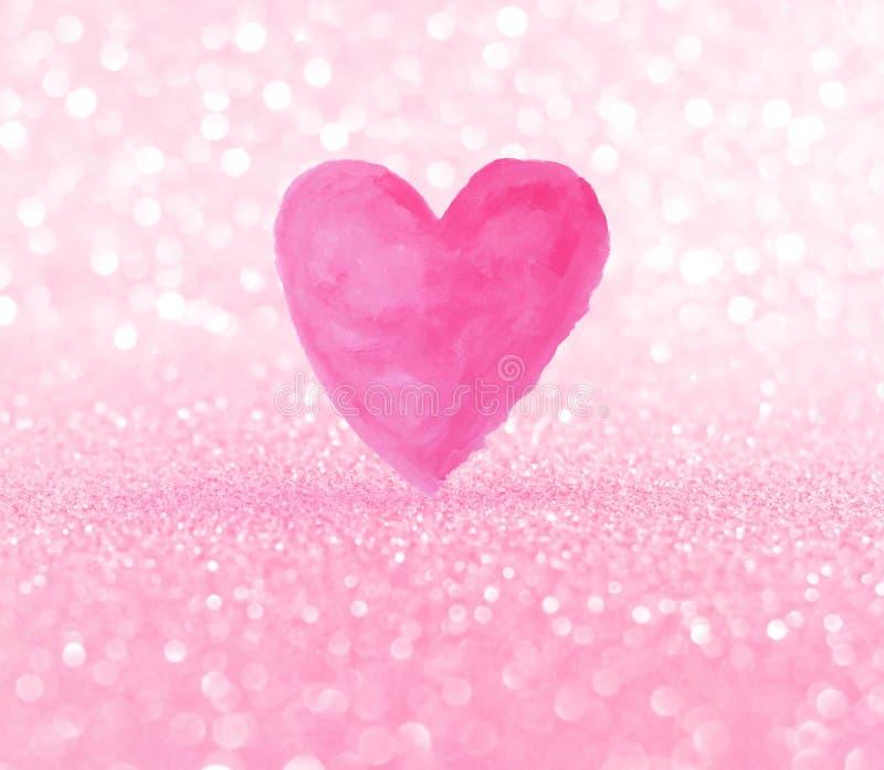 Forma rosada del corazón del waterclor en fondo del bokeh imagen de archivo libre de regalías
