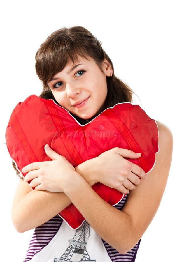 formad härlig red för flickahjärtakudde royaltyfri fotografi