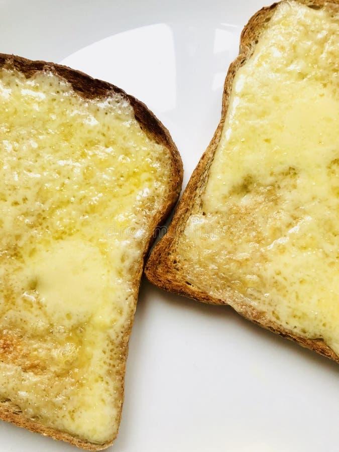 Formaggio su pane tostato immagine stock