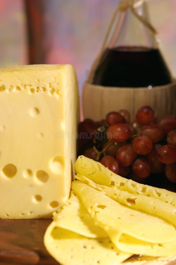 Formaggio, uva e vino. immagini stock