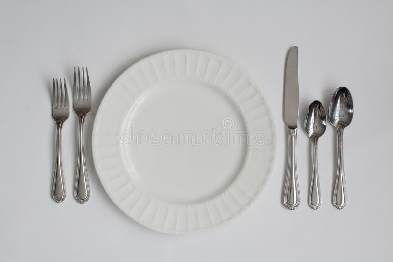 Formal Dinner Place Setting Utensils. A Formal Dinner Place Setting Utensils royalty free stock photos
