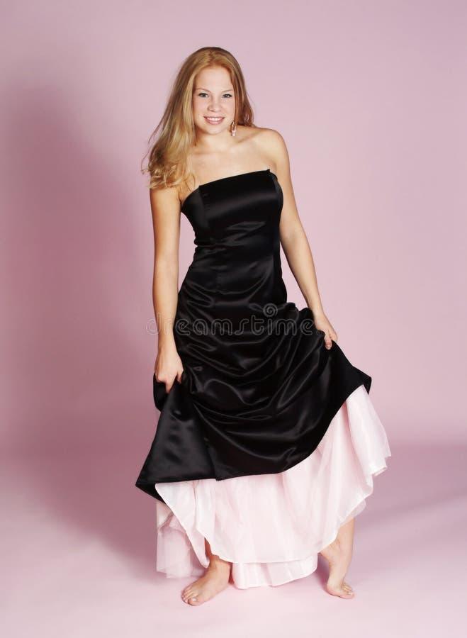 Formal dress. Young woman wearing formal dress stock photos