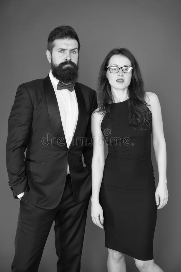 Formal dress code. Official event concept. Man bearded wear tuxedo girl elegant dress. Visiting event or ceremony stock image