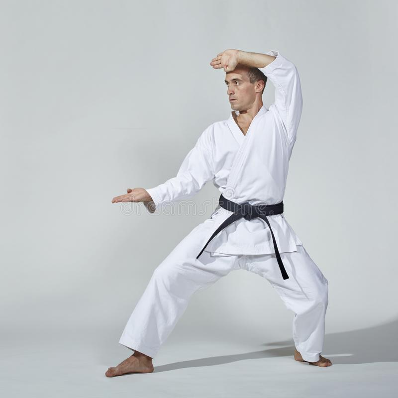 Formal exercises of karate performed by an adult athlete with a black belt royalty free stock photography