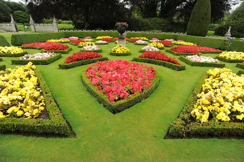 Download Formal Garden Beds With Urn Royalty Free Stock Photography - Image: 26219817