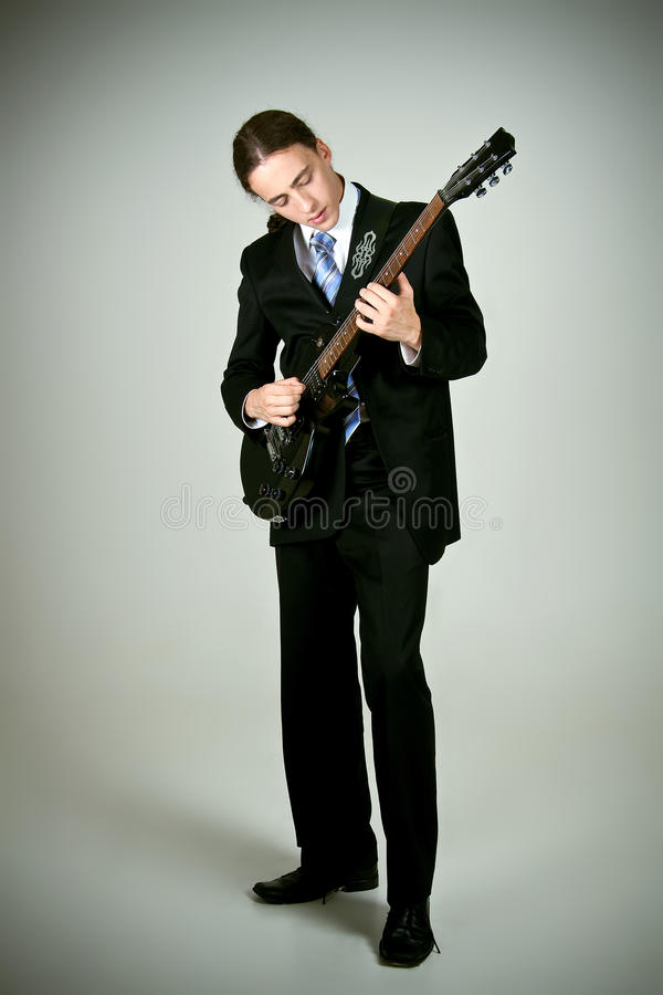 Formal man playing on guitar stock photography