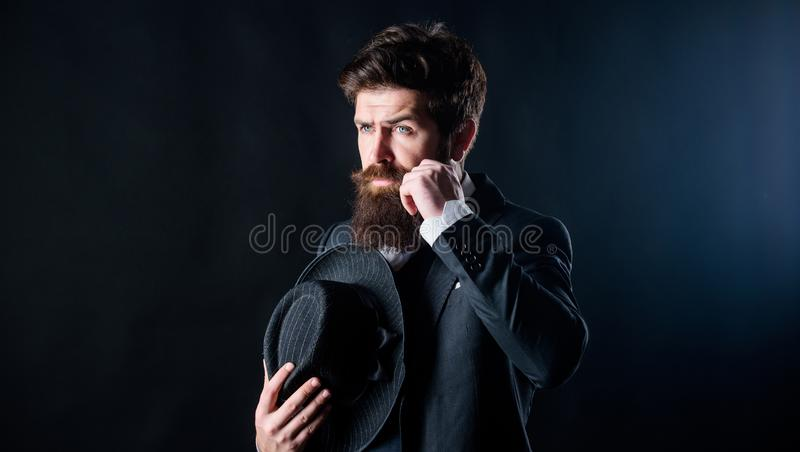 Formal suit classic style outfit. Elegant and stylish hipster. Retro fashion hat. Man with hat. Vintage fashion. Man royalty free stock photos