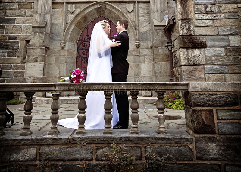 Formal wedding. A groom and bride standing on a castle balcony stock images