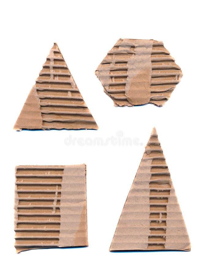 Formas acanaladas del papel del conjunto aisladas en blanco foto de archivo libre de regalías