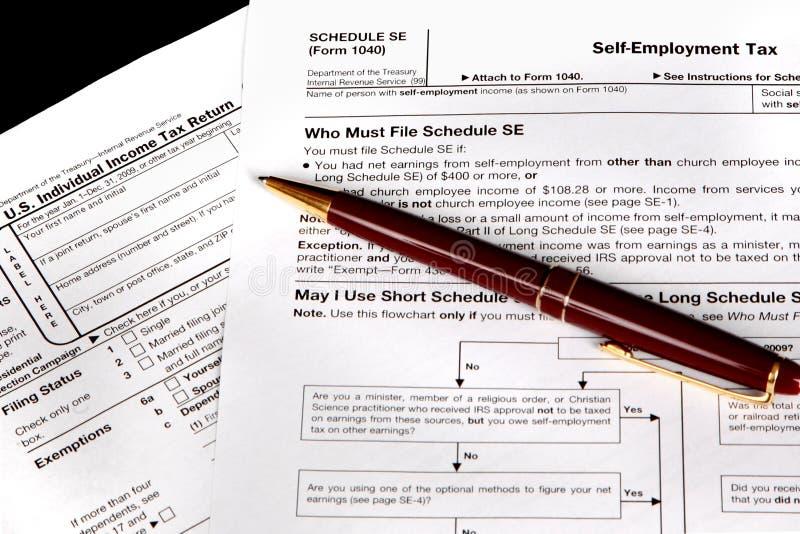 Formas de impuesto para el independiente imagen de archivo