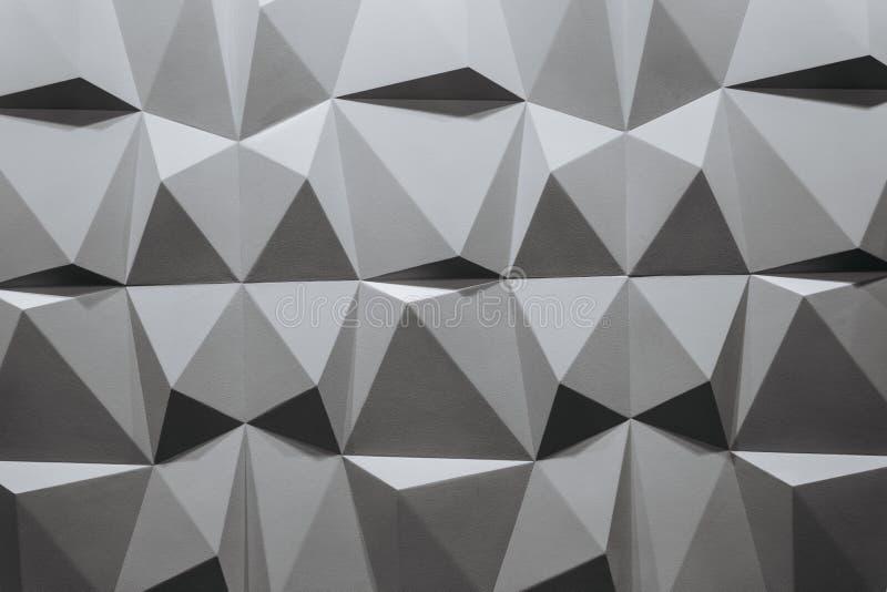 Formas geométricas blancos y negros que consisten en del papel pintado abstracto o del fondo geométrico: triángulos y polígonos foto de archivo libre de regalías