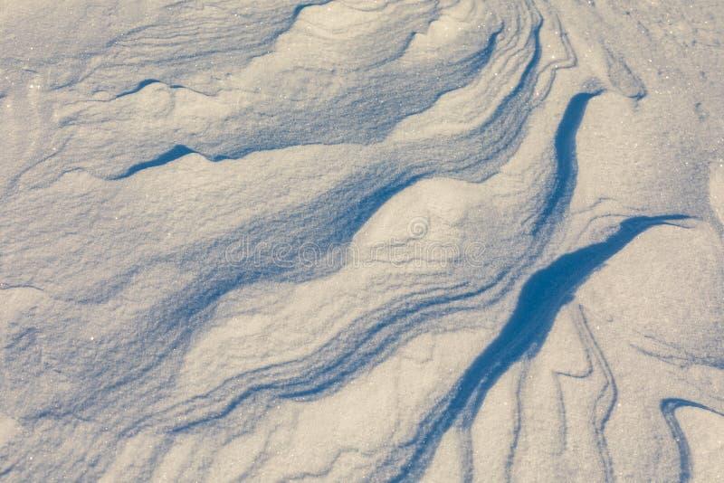 Formas y modelo abstractos del viento en nieve imagenes de archivo