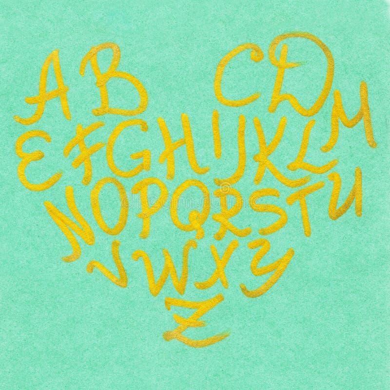 Format guld- guld- för alfabet hjärta på grön bokstävertypografiuppsättning stock illustrationer