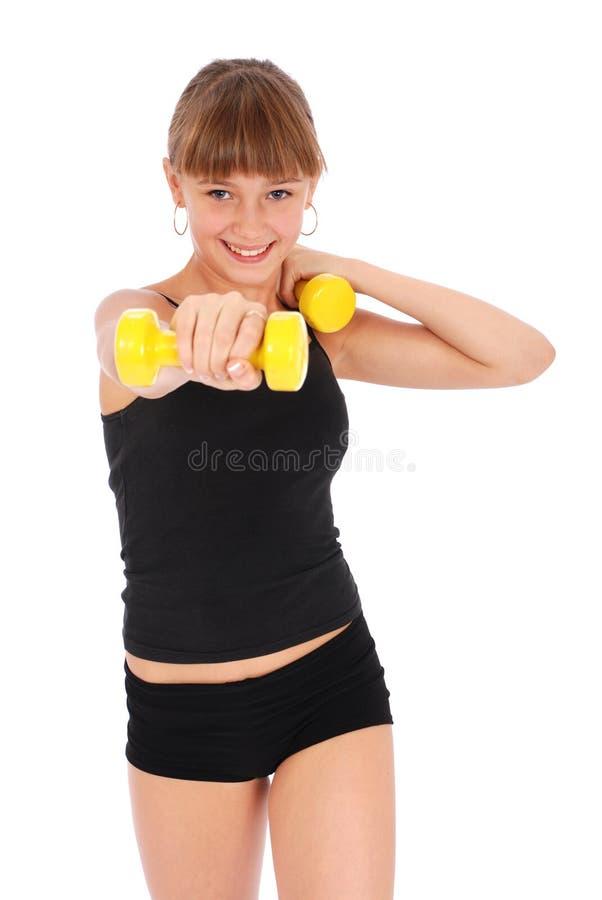 Formation de fille de forme physique de gymnastique son fuselage avec le dumbbel photographie stock