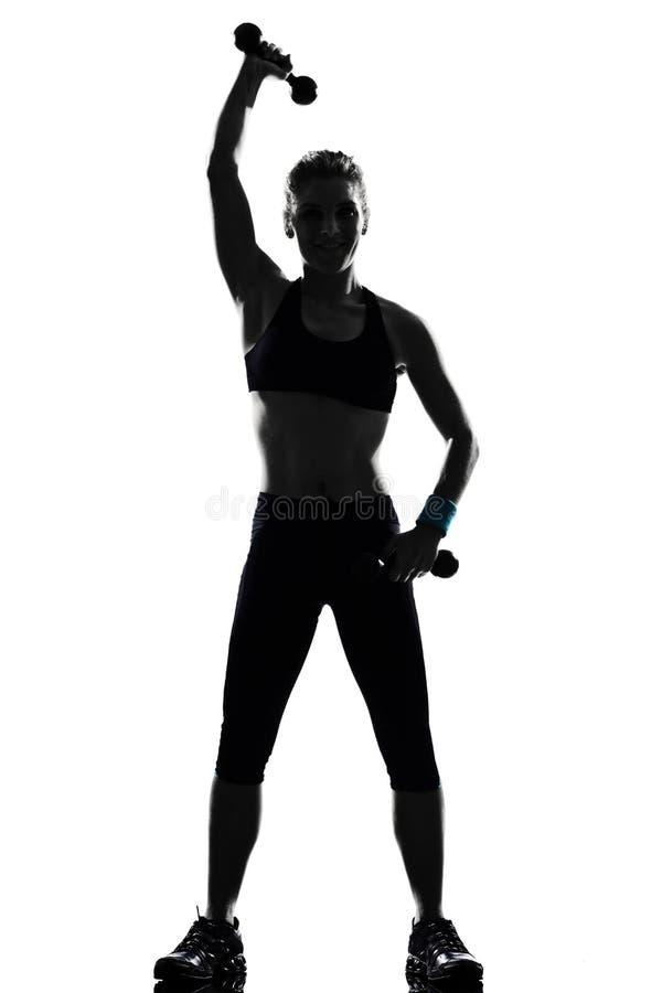 Formation de poids de maintien de forme physique de séance d'entraînement de femme images stock