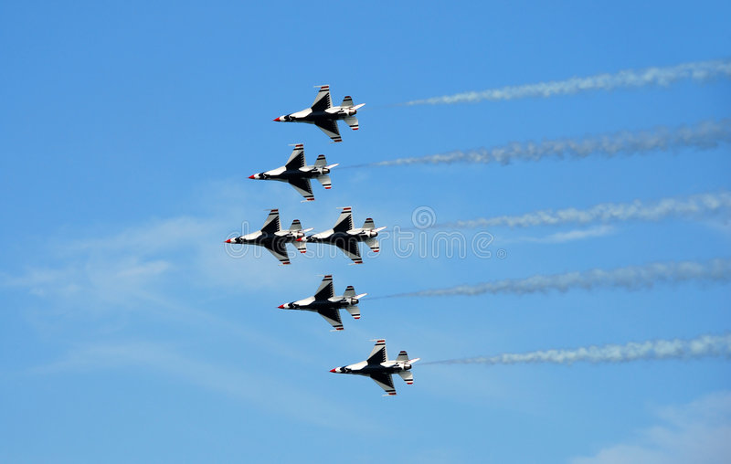 Formation of F-16 fighter jets. Thunderbirds flying overhead at airshow royalty free stock image