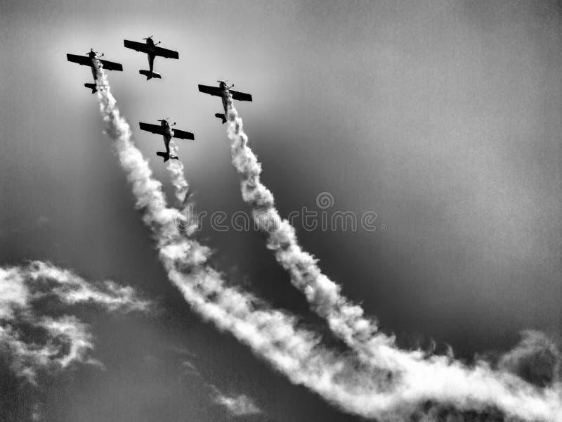 Last flight of four piston propeller aerobatic aicraft. stock images