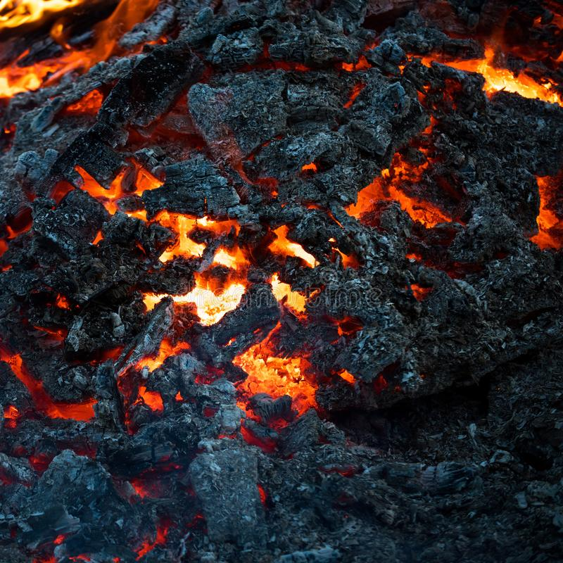 Formation, geology, nature, environment. Magma textured molten rock surface. Volcano, fire, crust. Danger hazard energy concept Lava flame on black ash stock photos