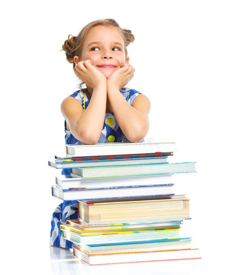 Formazione - ragazza divertente con i libri. fotografie stock libere da diritti