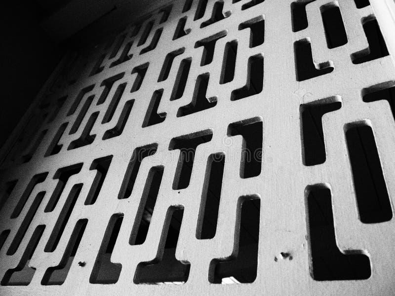Forme astratte monocromatiche in parete del blocco fotografie stock