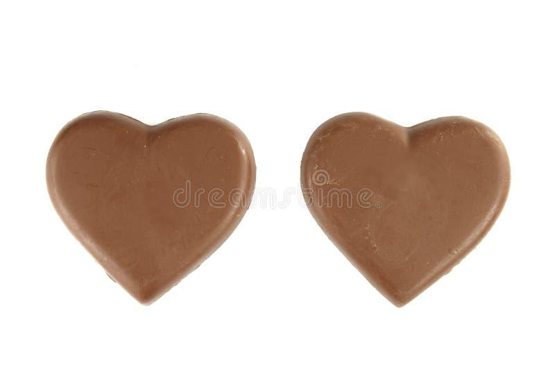 Forme de coeur de chocolat sur le blanc images stock