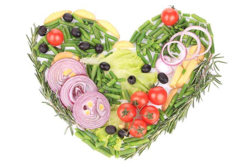 Forme de coeur faite avec de divers légumes images libres de droits