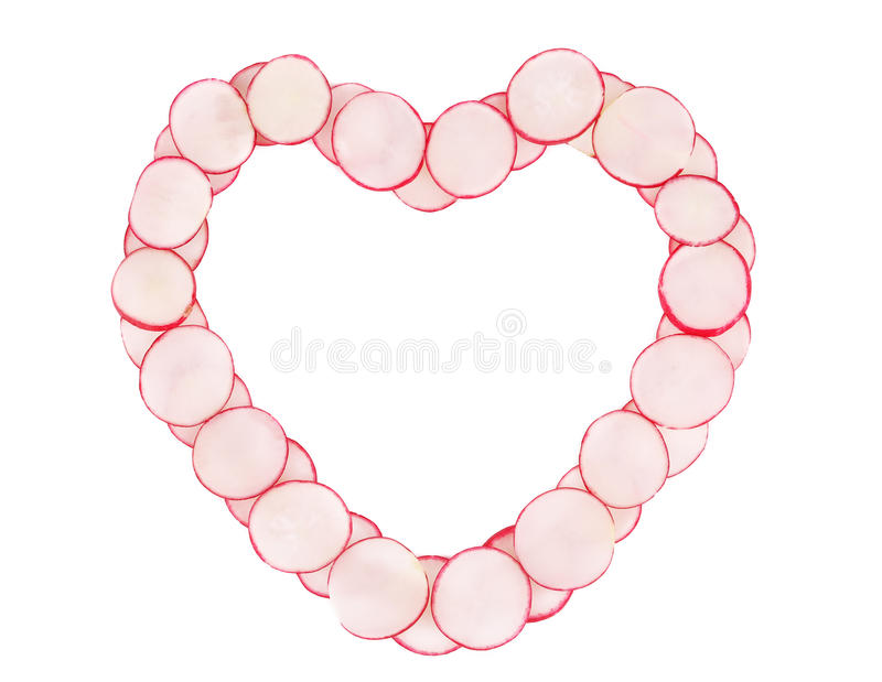 Forme de coeur faite de tranches de radis images stock
