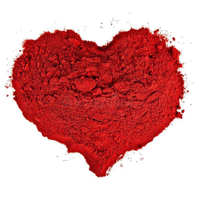 Forme de coeur faite en sable rouge fin. image libre de droits