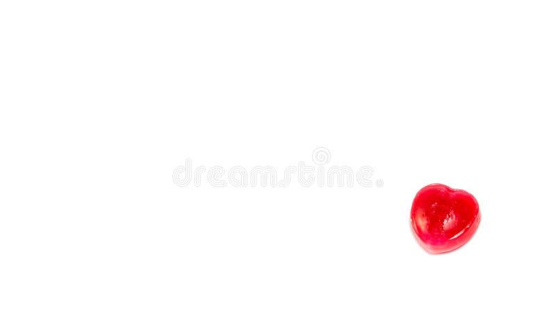 Forme de coeur de sucrerie rouge d'isolement sur le blanc photographie stock libre de droits