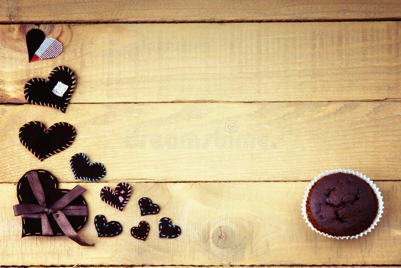 Forme del muffin e del cuore del cioccolato fotografia stock