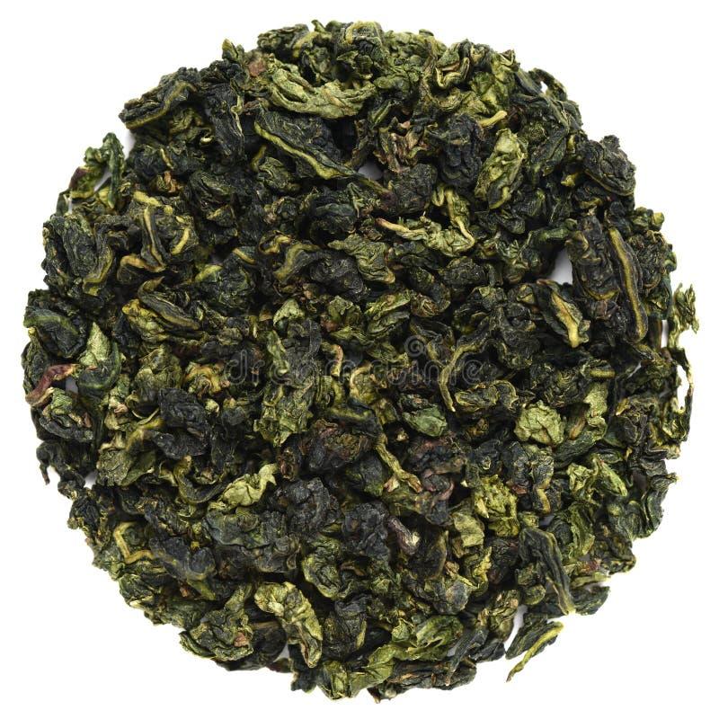 Forme ronde de thé de Te Guanin Oolong d'isolement sur le blanc photo stock
