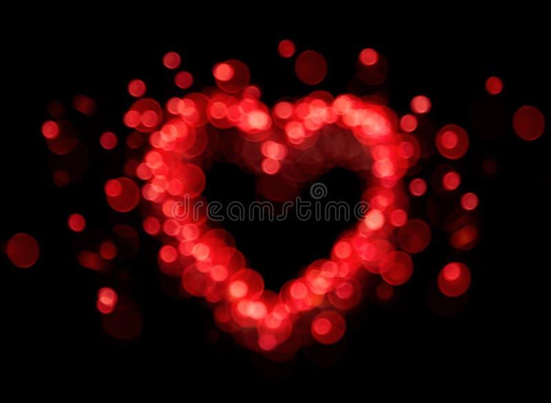 Forme rouge de coeur de bokeh photos stock