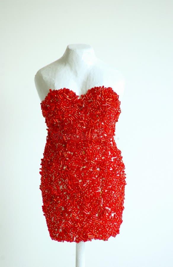 Forme sequined rouge de robe photo libre de droits