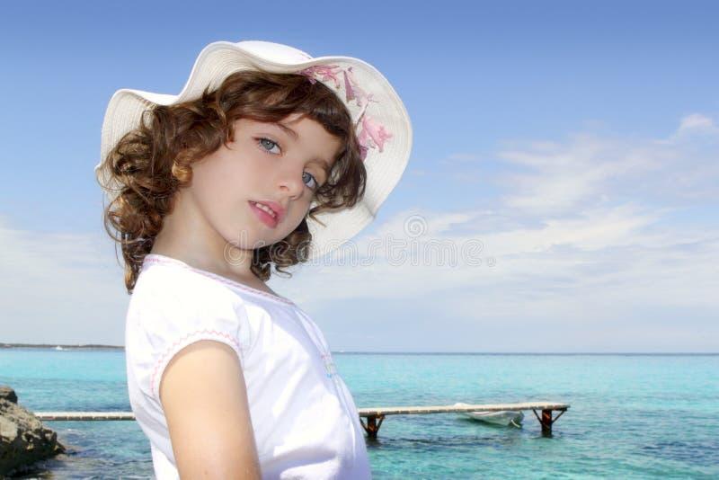 formentera女孩帽子少许海运游人绿松石 图库摄影