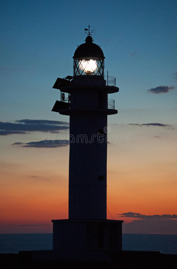 Formentera, Balearic Islands, Spain, Europe, lighthouse, Cap de Barbaria, sunset point, Mediterranean Sea, nature, landscape. Cap de Barbaria Lighthouse with the royalty free stock photo