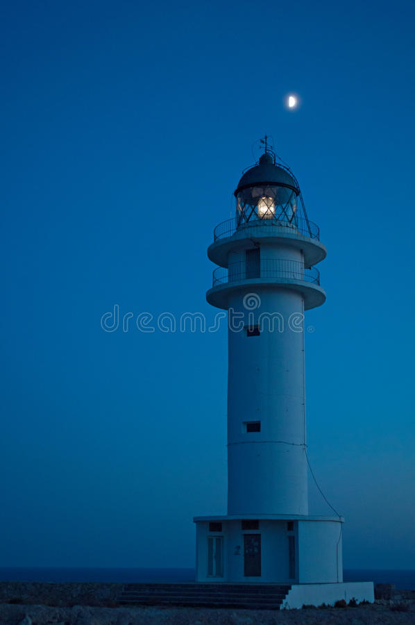 Formentera, Balearic Islands, Spain, Europe, lighthouse, Cap de Barbaria, sunset point, night, moon, moonlight, nature, landscape. The moon and Cap de Barbaria stock photography