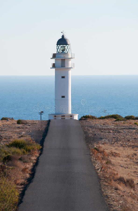 Formentera, Balearic Islands, Spain, Europe, lighthouse, Cap de Barbaria, sunset point, Mediterranean Sea, nature, landscape. The road, Mediterranean maquis and royalty free stock images