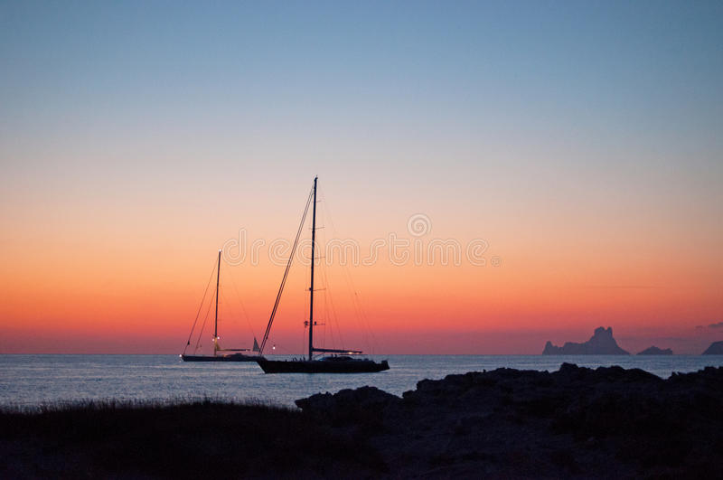 Formentera, Balearic Islands, Spain, Europe. Sailboats at Ses Illetes at sunset on September 6, 2010. Platja de ses Illetes, on the western side of the Trucador royalty free stock image
