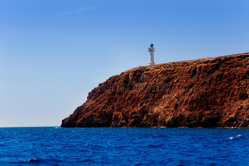 Formentera Barbaria cape Lighthouse view from sea. Boat stock images