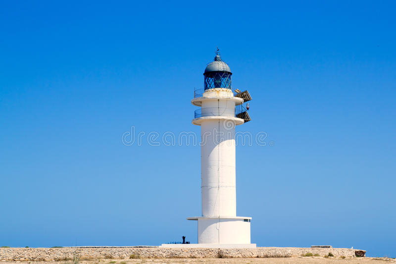 Formentera Barbria Lighthouse in blue sky. Mediterranean day stock photography