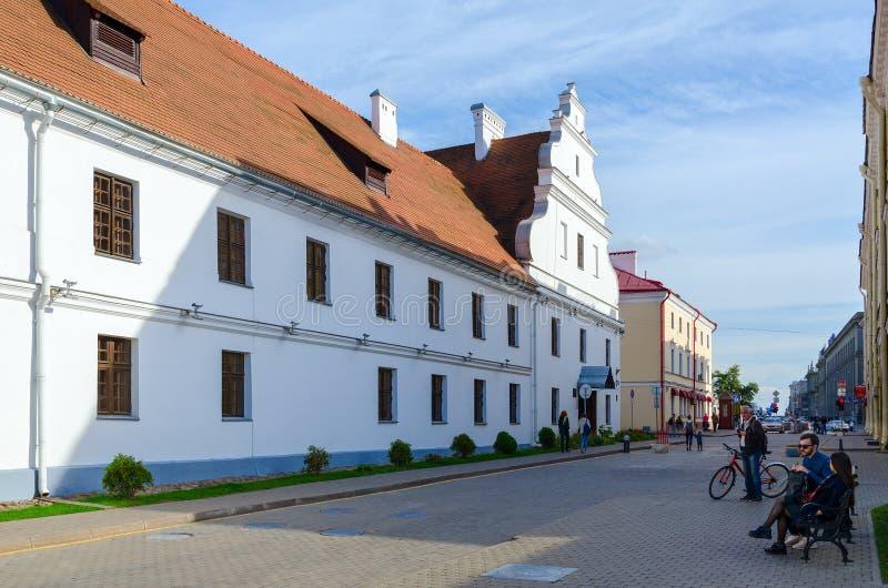 Former Basilian monastery, Minsk, Belarus. MINSK, BELARUS - OCTOBER 1, 2016: Unknown people are walking along street near former Basilian monastery now stock photos